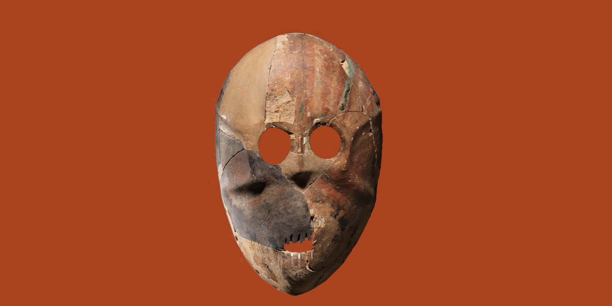 The picture shows a stone mask from prehistoric times